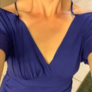 Arden B off shoulder top in bluish purple shade.